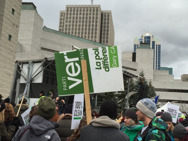 Protest sign using recycled Green Party sign. Fitting.
